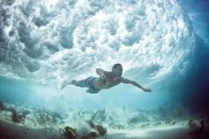 The great Aussie photographer Mark Tipple captures another underwater photograph of the waves crashing above his subjects.