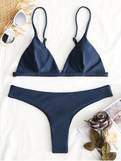 Solid, but not simple, this bikini set comprises a triangle top and cheeky thong bottoms. Suspended from adjustable thin straps and clean-cut lines will give you an even tan. Team yours with cat-eye sunglasses for a style with waterside allure. #Zaful #Swimwear #Bikini