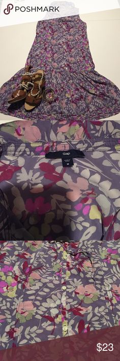 Beautiful Gap floral dress Gap Sz. M, 100% silk button front, sleeveless floral print dress. Beautiful lavender background with pink, red, green, and yellow print. Ruffle and drawstring around the neck.  This dress is about 38 inches long, comes to the knee, runs a little small, especially in the bust.  GAP Dresses Mini