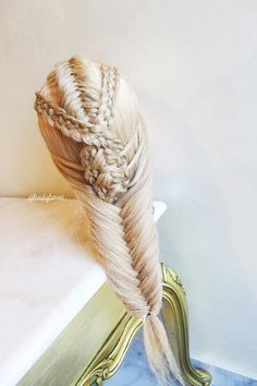 Combo braid (Dutch fishtail and five strand braids into a fishtail braid)