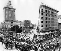 Raiders parade in downtown Oakland after winning the Super Bowl 1981. Crowd  fills the street at the corner of Broadway and 14th Street. (photo/Ron Riesterer)