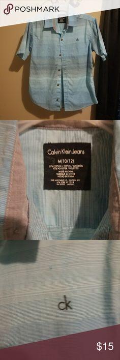 Boys blues shirt size 10/12. CK Boy's multi blue shirt size 10/12 by Calvin Klein. NWOT. Smoke free/pet free home Calvin Klein Shirts & Tops Button Down Shirts