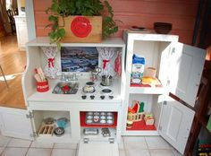 Tutorial: Kids Play Kitchen Made From Repurposed Kitchen Cabinets - This is a cute idea!