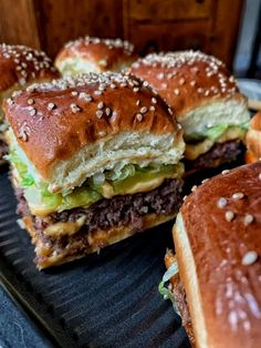 173 reviews · 30 minutes · Serves 12 · These mini Big Mac cheeseburgers are just like McDonalds, but better. These are the perfect party food. They also make a great dinner for a fun and different meal option. Kids and grown ups will love them! Big Mac, Crunchwrap Supreme, Cheese Burger, Hamburgers, Mcdonalds, Weeknight Meals, Easy Meals, Dinner Sandwiches, Food Porn