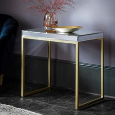 Plush Champagne Side Table  Introduce style into your room with this classy side table, featuring a bevelled mirror top and soft champagne metal frame.