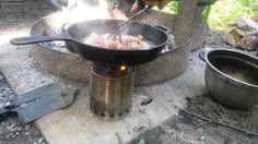 Lodge cast iron skillet, Solo Stove Titan and bacon.
