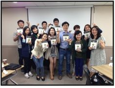 South Korean students studying Kolie Crutcher's ELECTRIC LIVING--The Science Behind the Law of Attraction