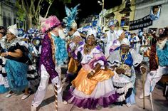 Montevideo, Uruguay A carnival group dances and plays Candombe, an Afro-Uruguayan music and dance st... - Matilde Campodonico/ASSOCIATED PRESS/AP Images