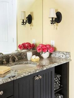 Black bathroom vanity and marble countertops - so pretty with buttercream yellow walls! Turning Oakleaf, a soft buttercream yellow, is PPG's 2014 Color of the Year.