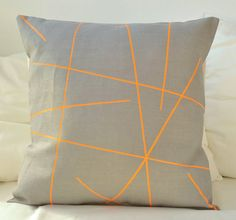 Grey linen with neon orange stripes pillow cover by PALEOLOCHIC