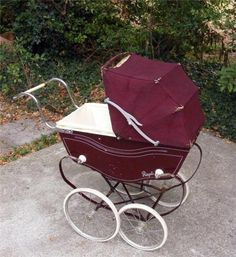 A beautiful vintage Royale dolls pram Coach built style pram similar to Silver cross, dating to 50's/60's Unusual wooden pram body Central brake Large wheels to back with smaller wheels to front Comes with original hood Padded interior with removable 3 section mattress