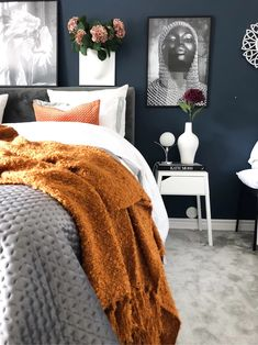 Dark blue walls compliment the greys and mustards of this bedroom Dark blue walls compliment the gre Dark Blue Feature Wall, Blue Feature Wall Bedroom, Dark Blue Bedroom Walls, Dark Blue Rooms, Grey Colour Scheme Bedroom, Blue Bedroom Decor, Dark Blue Walls, Bedroom Orange, Bedroom Colors