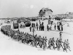 WWII - The D-Day Landings, German prisoners-of-war march along Juno Beach landing area to a ship taking them to England, after they were captured by Canadian troops at Bernieres Sur Mer, France on June (REUTERS/US National Archives) Normandy Beach, D Day Normandy, Normandy Ww2, Des Photos Saisissantes, Ww2 Photos, D Day Invasion, Us Army Rangers, Canadian Soldiers, Canadian Army