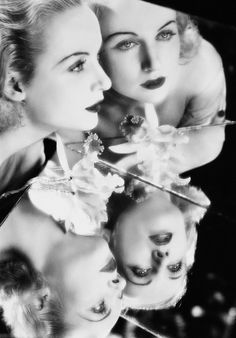 Carole Lombard reflected in two cracked mirrors. Photo by Otto Dyar.