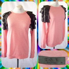 Pink Ruffled Faux Leather Shoulder Sweatshirt Sz M Lightweight pink sweatshirt from TOV with black faux leather ruffles at the shoulders. Scoop neck. Long sleeves. Fitted. Euro Size 38 converts to a Size 6/ Small. TOV Sweaters