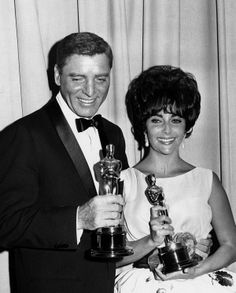 """Photo of Burt Lancaster and Elizabeth Taylor holding their Oscars. Lancaster earned the Best Actor award for """"Elmer Gantry,"""" and Taylor won Best Actress for her role in """"Butterfield 8."""" 1961"""
