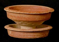This incense cup forms part of the funerary assemblage from a Phoenician rock cut tomb in Rabat, Malta which dates to the 7th century BC. Like most local Phoenician pottery it is very plain, with the only decoration being a red slip covering. Polishing the slip before firing gave the surface a red sheen, possibly done to imitate the sheen more expensive bronze vessels had. This type of pottery vessel, the incense cup, was usually used during special occasions such as funerary rituals.