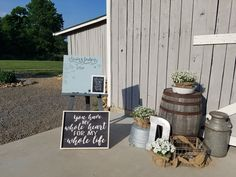 Whiskey barrel with baby's breath guestbook sign