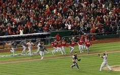 Cardinals players including catcher Tony Cruz and closer Jason Motte (30) celebrate the final out during Game 5 of the National League Division Series between the St. Louis Cardinals and the Washington Nationals on Friday, Oct. 12, 2012, at Nationals Park in Washington, D.C.