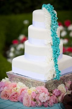 I love this simple elegant teal wedding cake. But instead of the white next to the teal i'd make it purple!