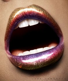 Iridescent lip. Start w/ sparking gold liner, fill in w/ gold lipstick/wet shimmery gold shadow. Middle of both top  bottom lip fill in shimmery pink, inner of bottom  top lip fill w/ sparkly purp.