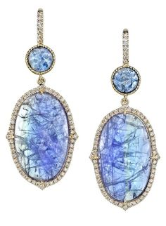 Tanzanite and sapphire drop earrings. Handmade in 18kyg with tanzanite slices weight 12.65cts topped with round sapphire slices weighing 1.53cts. The earrings are outlined in a pave diamond border.