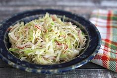 This is a great tasty coleslaw recipe, perfect for topping a pulled pork sandwich or fish tacos. This coleslaw is made with a hot vinegar dressing.