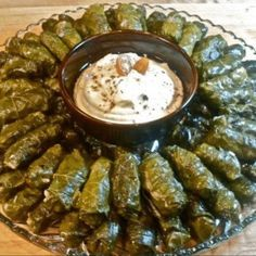 Stuffed grape leaves and hummus. We have tons of grape leaves that grow along our fence. I can't wait to try making these this year Another Lebanese dish! Comida Israeli, Israeli Food, Middle East Food, Middle Eastern Recipes, Kosher Recipes, Cooking Recipes, Grape Leaves Recipe, Rainy Day Recipes, My Favorite Food