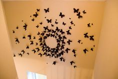 Butterfly wall art. This looks way better than the way I usually see these types of 3D wall art: just 4 or 5 going in one direction.