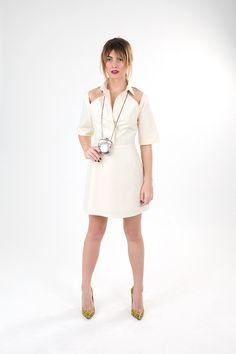 White linen short dress with shoulder cut-outs.