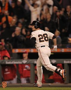 Posey watches his 18th home run disappear into the night.