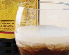 Kahlúa White Russian - Into a rocks glass with ice, pour 1 oz coffee flavoured Kahlúa and 1 oz Polar Ice Vodka. Layer by topping slowly with milk or cream. Garnish with a cinnamon stick.