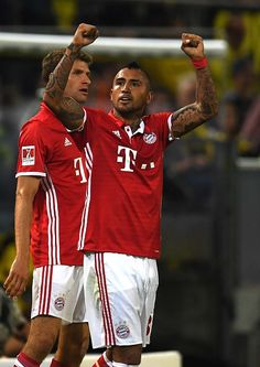 Bayern Munich's Chilean midfielder Arturo Vidal celebrates during the German Super Cup football match final Borussia Dortmund vs FC Bayern Munich in...