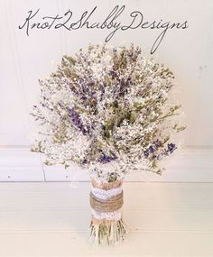 Baby's breath and lavender bouquet. Follow us on Instagram under knot2shabbydesigns for 5 % off your wedding order!