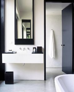 Strong black and white graphics in this bathroom at the Amansara resort in Cambodia.