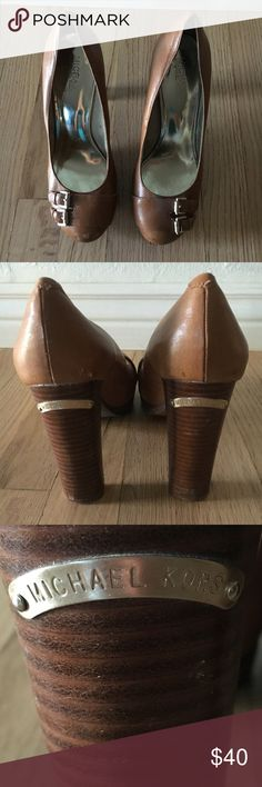 """Michael Kors Tan Thick Heel Pumps. Size 7. Michael Kors Thick Heel Pumps. Tan/beige leather with man-made sole. 5"""" stacked chunky heel. Round toe.Silver metallic trim and buckle. Michael Kors charm to back of heel. Used but good condition. Scratches to leather in the toes. Michael Kors Shoes Heels"""