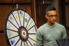 A drug court participant walks away from a prize wheel in the Lyon County Courthouse on Wednesday after having the opportunity to spin it in return for successful progress in the drug court program. Buy this Prize Wheel at http://PrizeWheel.com/products/floor-prize-wheels/big-40-prize-wheel/.