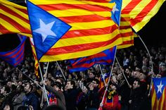 FC Barcelona supporters wave pro-independence Catalan flags during the La Liga match between FC Barcelona and Villarreal CF at Camp Nou on December 14, 2013 in Barcelona, Catalonia.