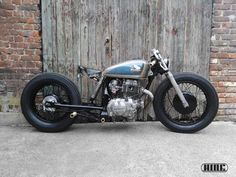 Max & Jérôme, owners of custom motorcycle workshop and café HIDE Brussels, create awesome machines with their… Honda Bobber, Cafe Racer Honda, Motos Bobber, Honda Cb400, Bobber Bikes, Cafe Bike, Cafe Racer Bikes, Bobber Chopper, Cafe Racer Motorcycle
