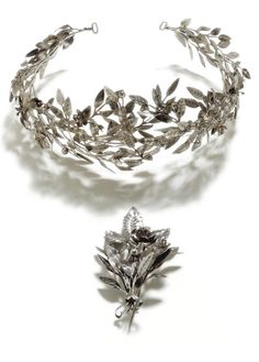 A SILVER TIARA AND BROOCH, MAKER'S MARK P.T. IN CYRILLIC, ST PETERSBURG, 1870-1900, the tiara designed as flowering sprays of myrtle, the brooch of matching design centring on a single rose flower head, 84 standard, Quantity: 2, width: 18.5cm at widest point