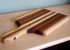 Walnut and Maple Paddle Wood Cutting Board.