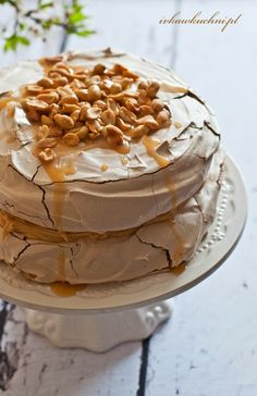 Pavlova with peanut butter, caramel sauce & roasted peanuts