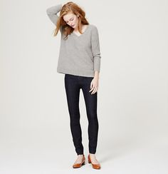 """Cut with a high waist for modern appeal, this skinny stretch ankle pair flaunts a clean and classic dark blue wash. Front zip with button closure. Wide belt loops. Five-pocket styling. Tonal topstitching. 28"""" inseam. To give you the best possible fit, we've changed our denim sizing to waist sizes. Use the following list to compare sizes: 24=00, 25=0, 26=2, 27=4, 28=6, 29=8, 30=10, 31=12, 32=14, 33=16, 34=18"""