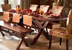 Pier 1 Daisy Dining Chairs and Nolan Extending Trestle Table and Bench are defined by rustic details