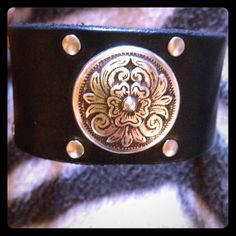 ❤Studded Leather Cuff with Floral Medallion❤️ Beautiful floral and studded leather cuff.Almost Celtic in style. Brand new never worn. It has sat in a container with other leather cuffs for about a year but it is in perfect condition. Ask if qs Jewelry Bracelets