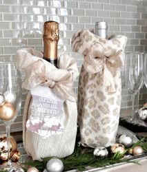Wonderful Wine Bottle Gift Bags.   This easy-to-make sewing project will yield an elegant cozy for a bottle of bubbly. This a homemade bag strung together with a decorative ribbon.