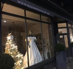 """Bridal Boutique London on Instagram: """"All is calm, all is bright✨  Christmas windows....... @pronovias ballgown with detachable sleeves."""" Christmas Windows, Mirror Mirror, Bridal Boutique, Ball Gowns, Calm, Bright, Display, London, Wedding Dresses"""