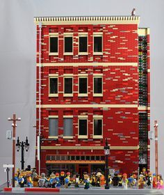 Michael J. built a highly detailed furniture shop located in an urban setting. The four story building is full of street level details, including scaffolding, electrical poles and street lights.