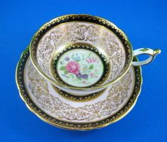 Black and Pink Border with Gold and Floral Center Paragon Tea Cup and Saucer Set