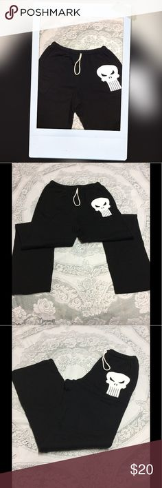 American Apparel Fleece Joggers Like new condition American Apparel black joggers with warm fleece material and featuring a white scull and elastic waist band. American Apparel Pants Track Pants & Joggers